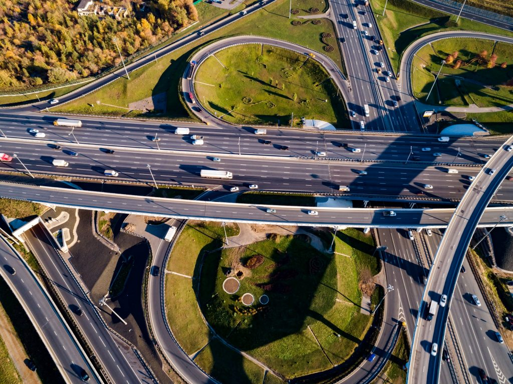 Aerial view of a freeway intersection traffic trails in Moscow.