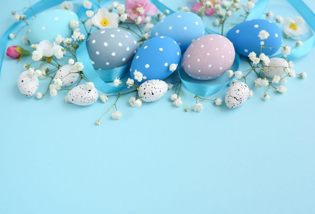 Easter eggs on a blue background. Festive easter background