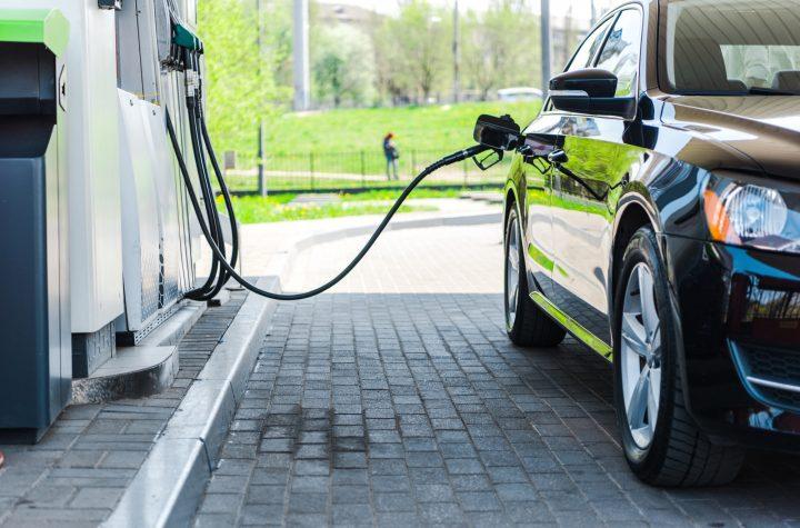 black modern car refueling with benzine on gas station