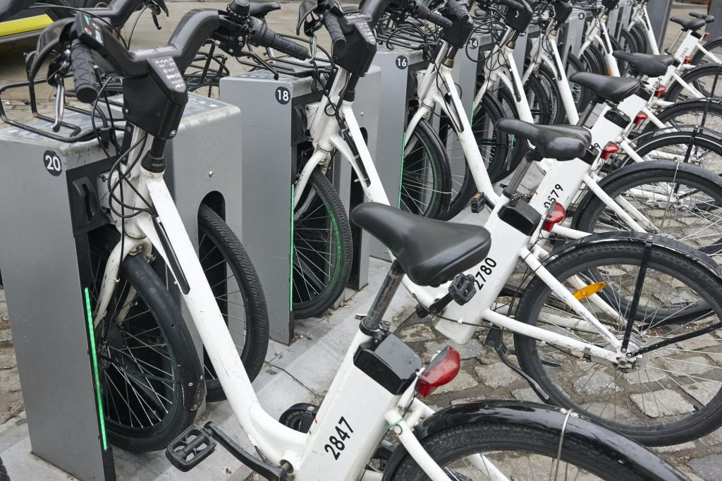 Charging electric bikes in the city. Urban green transportation. Horizontal